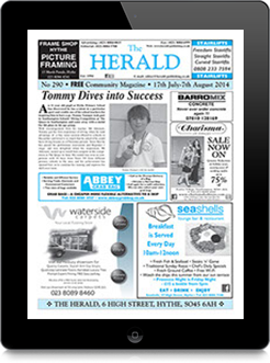 Image of a iPad displaying The Herald's e-Issue.